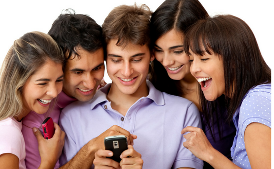 5 people looking at a mobile phone laughing